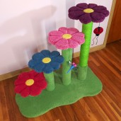 Shown here with grass green base/posts & matching sisal.  Flowers are raspberry, sky blue, carnation pink, and plum. Toys shown are ladybug and dragonfly.