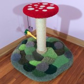 """Shown here with 11"""" mushroom cap in 20"""" height w/ red & white mushroom, moss green base, natural sisal, dense moss patches & 6 stones on the base. Also, with Dragonfly toy (yellow)."""